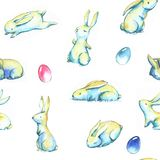 Easter pattern. Hand-drawn watercolor seamless pattern with cute little Easter bunnies on the white background. Repeated print with rabbits and colored eggs Vector Illustration