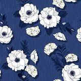Hand drawn white blooming flowers on monotone blue leaves and te. Xture background vector seamless pattern on dark blue Stock Image