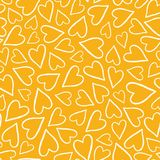Hand drawn white tossed heart outlines pattern on a yellow background. A pretty vector seamless repeat pattern ideal for royalty free illustration