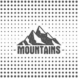 Hand drawn wilderness old style typography poster with retro mountains. Letterpress Print Rubber Stamp Effect. Halftone Royalty Free Stock Image