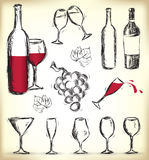 Hand-drawn wine design elements. Collection of hand-drawn glasses, bottles of wine and grapes Royalty Free Stock Images