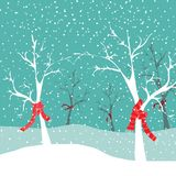 Winter trees with red Christmas scarfs in snow nature. Vector illustration on blue snowing background Royalty Free Stock Images