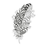 Hand drawn zentangle feather on white background. Coloring for adults. taVinge tribal feather.  vector illustration, design element Stock Photos