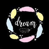 Hand drawnillustration in boho style with handdrawn feathers and word Dream handlettering Royalty Free Stock Photography