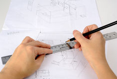 Hand is drawning sketch of the kitchen with pencil and ruler Stock Photo