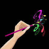 Hand  draws. The hand of the artist drawing the pattern Royalty Free Stock Photography
