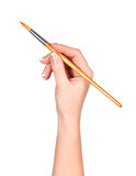 Hand draws a brush on an Royalty Free Stock Images