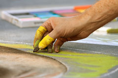 Hand Draws Chalk Art On Street At Fall Festival Stock Photos