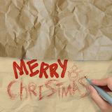 Hand draws Christmas Card on wrinkled paper Royalty Free Stock Photography
