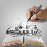 Hand draws a dream house. Open book of hand draws a dream house Royalty Free Stock Photos