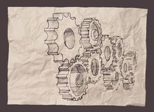 Hand draws gear to success concept on crumpled paper Royalty Free Stock Images