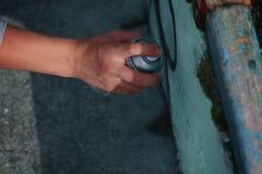 Hand draws graffiti on the wall Royalty Free Stock Photography