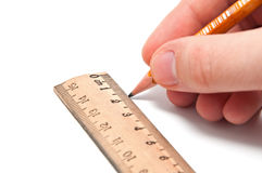 Hand draws a line with a pencil and ruler Stock Photography