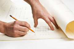Hand draws a pencil on drawing. Hand draws a pencil on the drawing Royalty Free Stock Photos