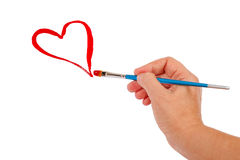 Hand draws a red heart Royalty Free Stock Image