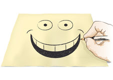Hand that draws a smile Royalty Free Stock Photo
