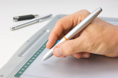 Hand draws on the tablet Stock Photography