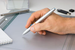 Hand draws on the tablet Royalty Free Stock Photos