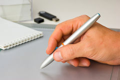 Hand draws on the tablet Royalty Free Stock Photography