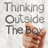 Hand draws think outside the box with crumpled paper background Royalty Free Stock Image