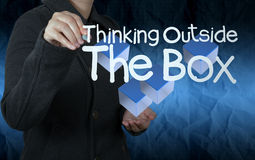 Hand draws think outside the box with crumpled paper background Royalty Free Stock Photo