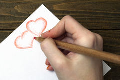 Hand draws two hearts pencil Royalty Free Stock Photo