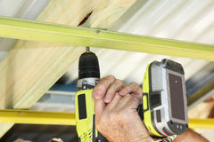 Hand drill. A cordless hand drill used to put ceiling battens Stock Photo