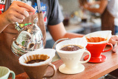 Hand drip coffee, Barista pouring water on coffee ground with fi Stock Photo