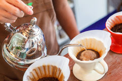 Hand drip coffee, Barista pouring water on coffee ground with filter Royalty Free Stock Photos