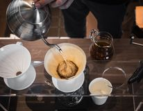 Hand drip coffee Barista pouring water on coffee ground with filter royalty free stock photography