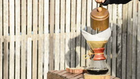 Hand drip coffee front of the wood fence at seaside stock video