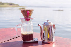 Hand drip coffee set, metal drip glass pitcher in vintage tone Royalty Free Stock Photo