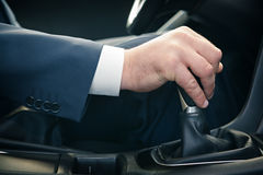 Hand of  driver of the car Royalty Free Stock Photo