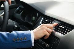 The hand of the driver of the car opens the air intake on the car. Panel Stock Image