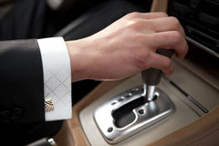 Hand of the driver of the new car Stock Photography