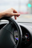 Hand of the driver on a steering wheel Royalty Free Stock Images