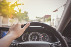 Hand of driver on steering wheel of car Royalty Free Stock Images