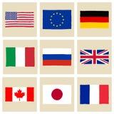 Hand drog flaggor G8 Arkivfoto