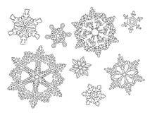 Hand drog snöflingor på viten Arkivbilder