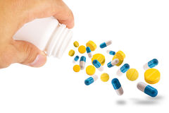 Hand drop Various pills for use Royalty Free Stock Image