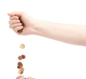 Hand dropping multiple change coins Stock Photo