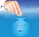 Hand drops piggy bank Stock Photos