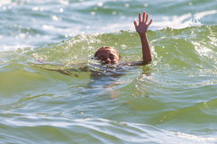 Hand of drowning little girl needing help assistance Royalty Free Stock Photos