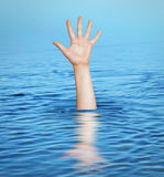 Hand of drowning man. Help. Royalty Free Stock Photos