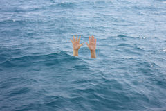 Hand of drowning man in see. Stock Images