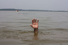 Hand of drowning man waits for help Royalty Free Stock Photography