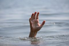 Hand drowning Royalty Free Stock Photo