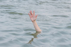 Hand drowning in the sea Stock Image