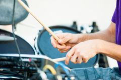 Hand of drummer closeup Stock Images