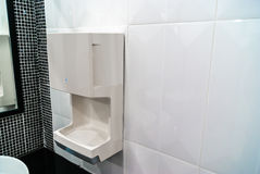 Hand dryer on ceramic wall, Hygienic and high technology of the. Toilet stock photos